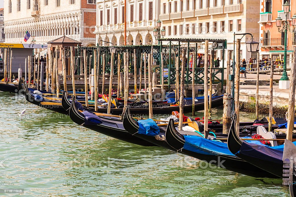 Gondolas docked at a harbour in Venice stock photo