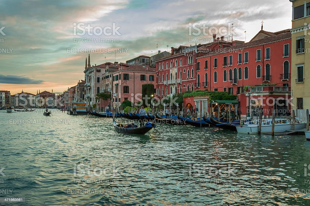 Gondolas floating on the Grand Canal at sunset in Venice royalty-free stock photo