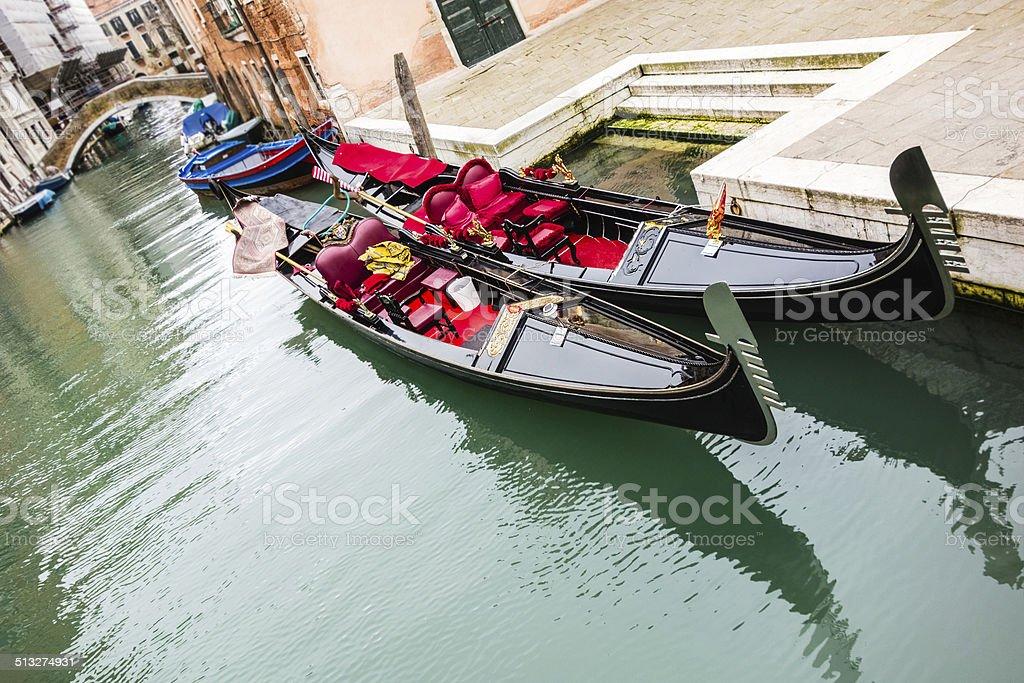 Gondolas in a calm canal stock photo