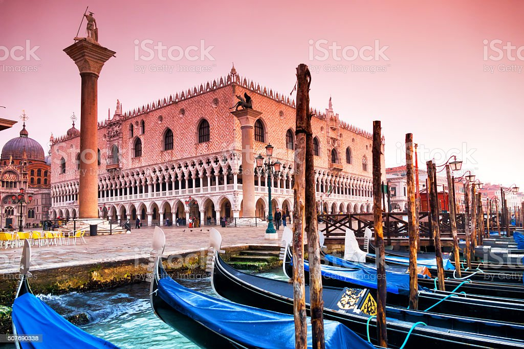 Gondolas in front of Doge's Palace, Venice, Italy - pink stock photo