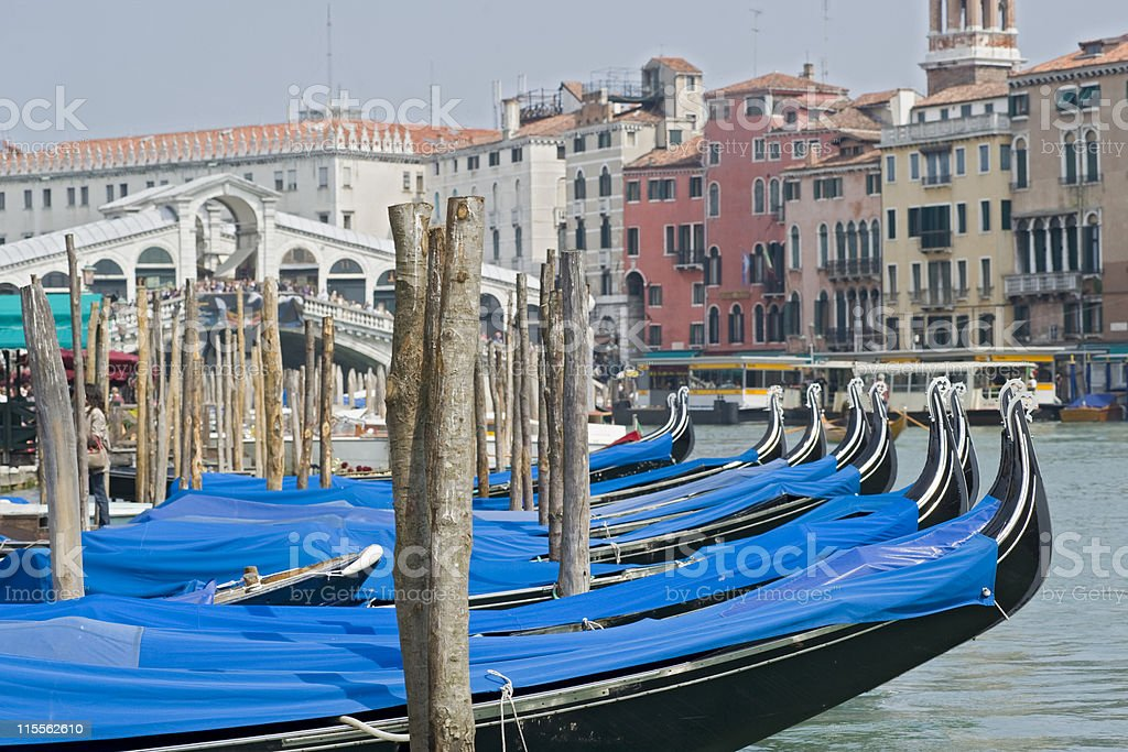 Gondolas in front of Rialo Bridge, Grand Canal, Venice royalty-free stock photo