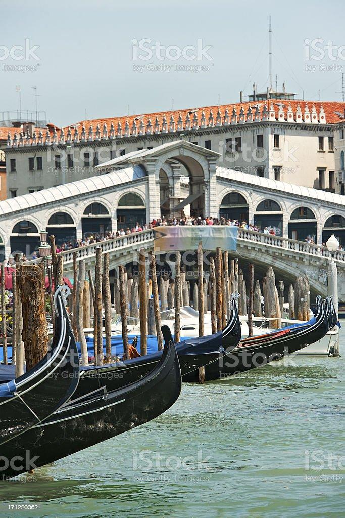 Gondolas in front of Rialo Bridge, Grand Canal, Venice royalty-free stock photo