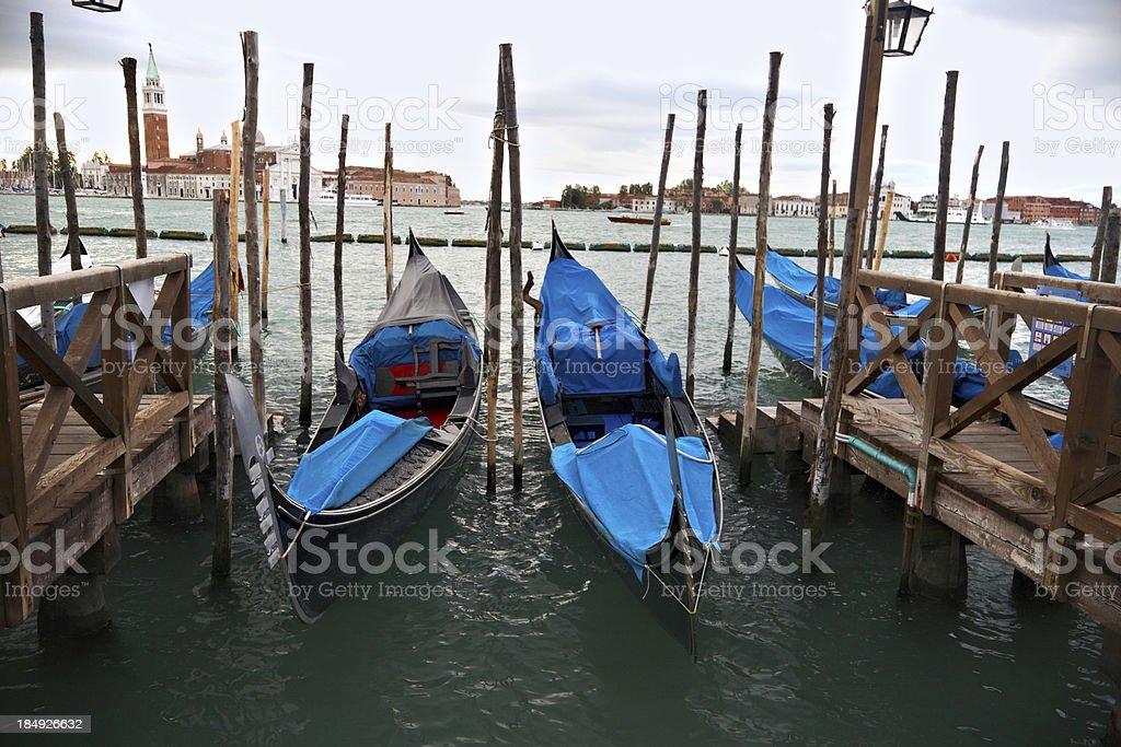 Gondolas in San Marco's basin with dramatic sky royalty-free stock photo