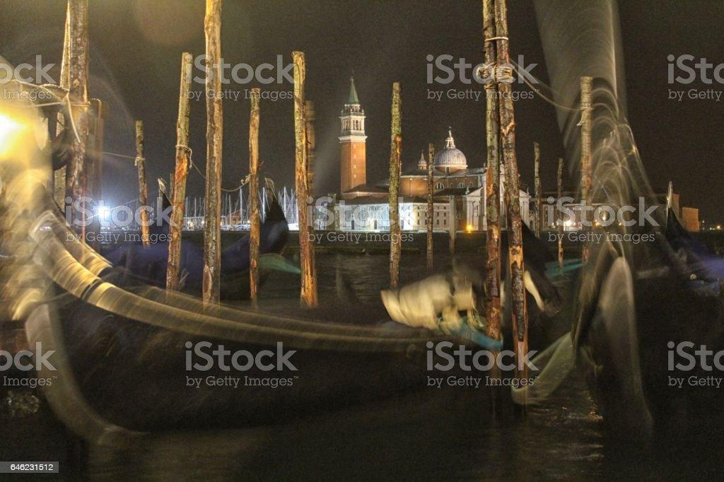 Gondolas in the Venice night stock photo