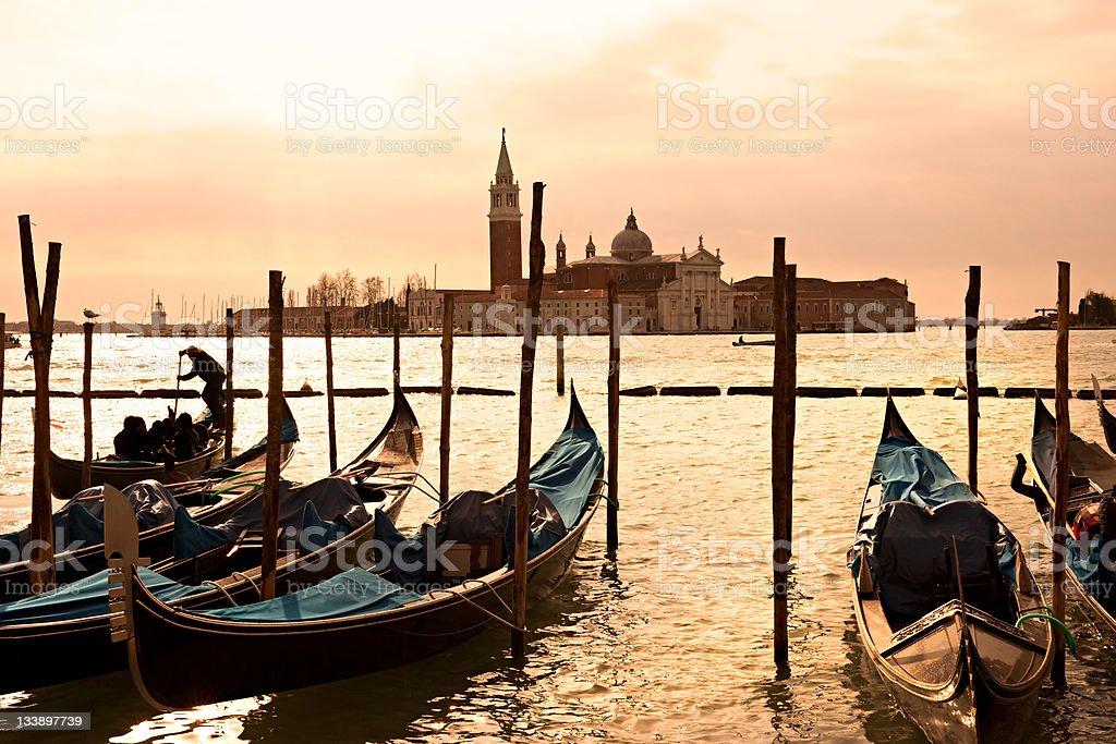 Gondolas in Venice at dusk. Italy. royalty-free stock photo