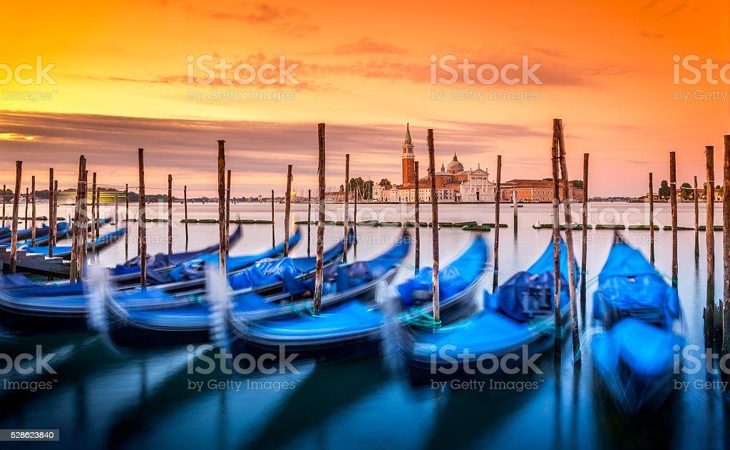 Gondolas in Venice at sunrise stock photo