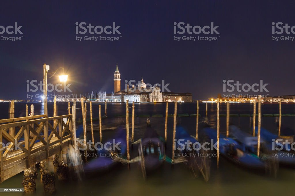 Gondolas in Venice in the night stock photo