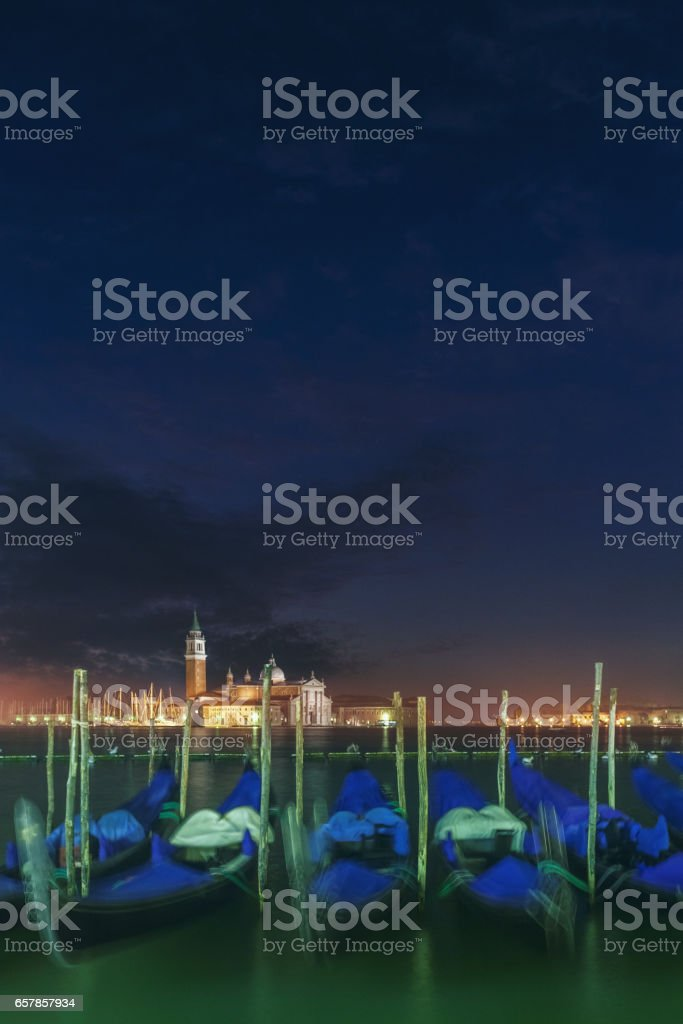 Gondolas in Venice in the night stock photo