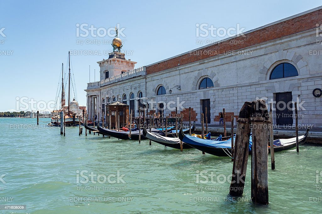 Gondolas moor in front of church. royalty-free stock photo