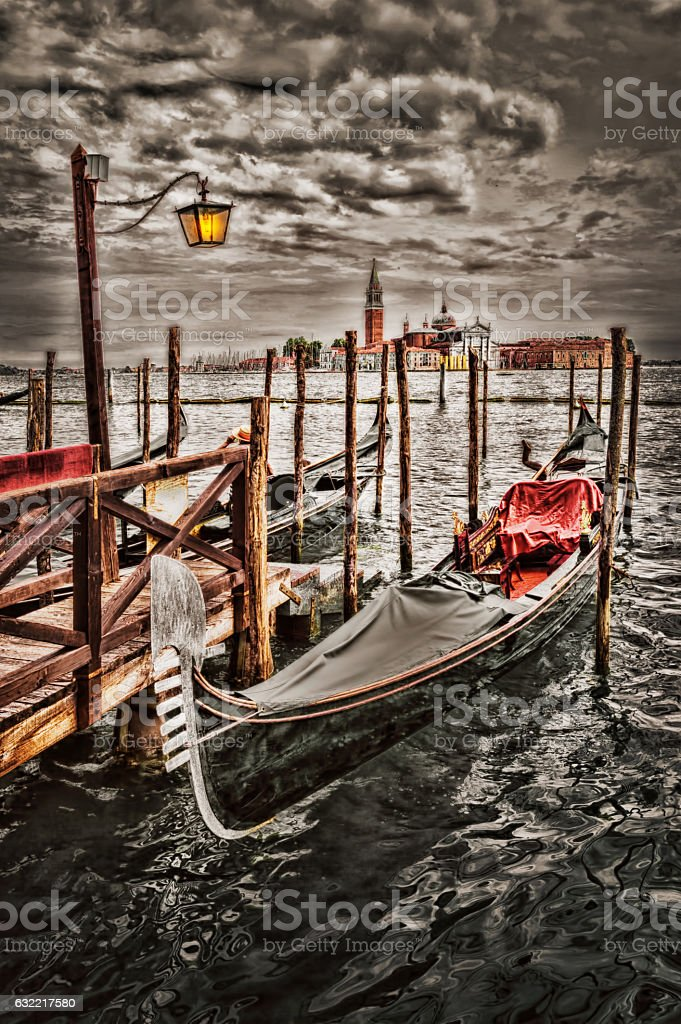 Gondolas moored by Saint Mark square stock photo