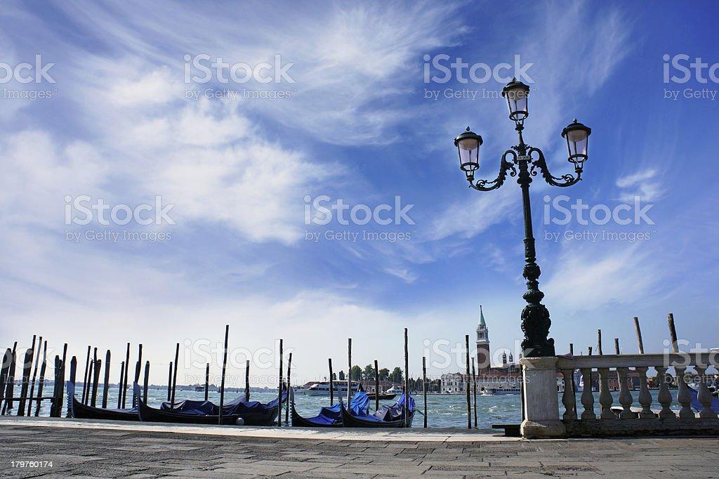 Gondolas moored by Saint Mark square. Venice, Italy, Europe royalty-free stock photo