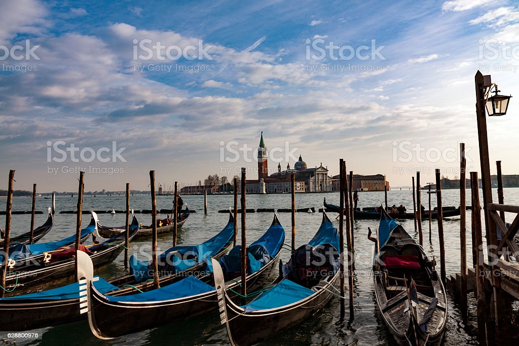 Gondolas moored by Saint Mark square. Venice, Italy, Europe stock photo