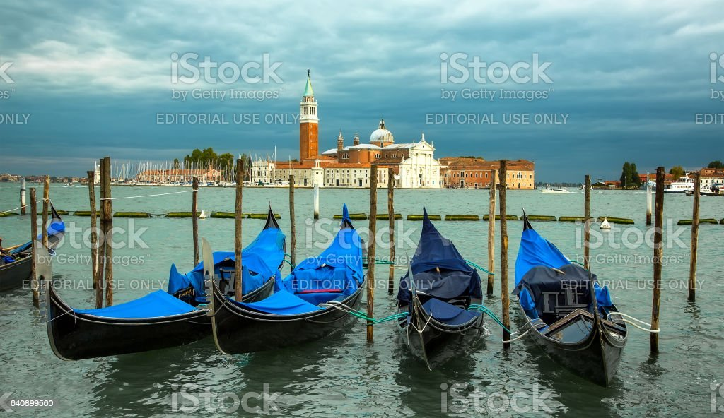 Gondolas moored by Saint Mark square with San Giorgio di Maggiore church stock photo