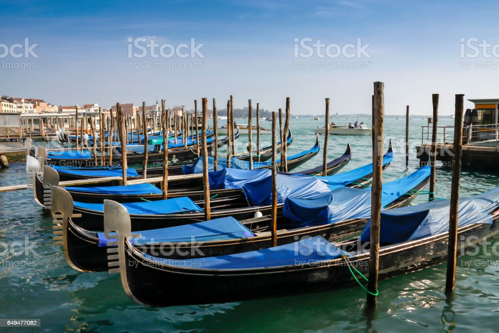 Gondolas moored in front of Saint Mark square stock photo