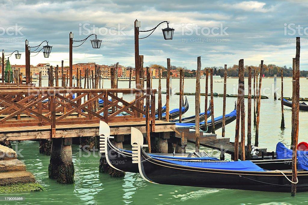 Gondolas moored in row on Grand canal. Venice, Italy. royalty-free stock photo