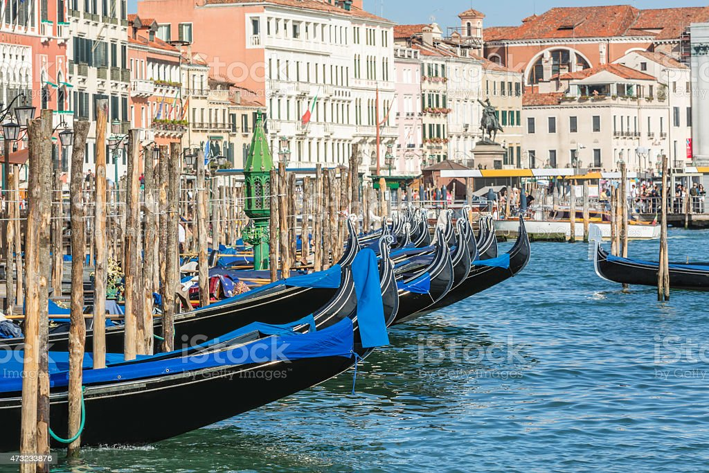 Gondolas moored in the grand canal in Venice, Italy stock photo