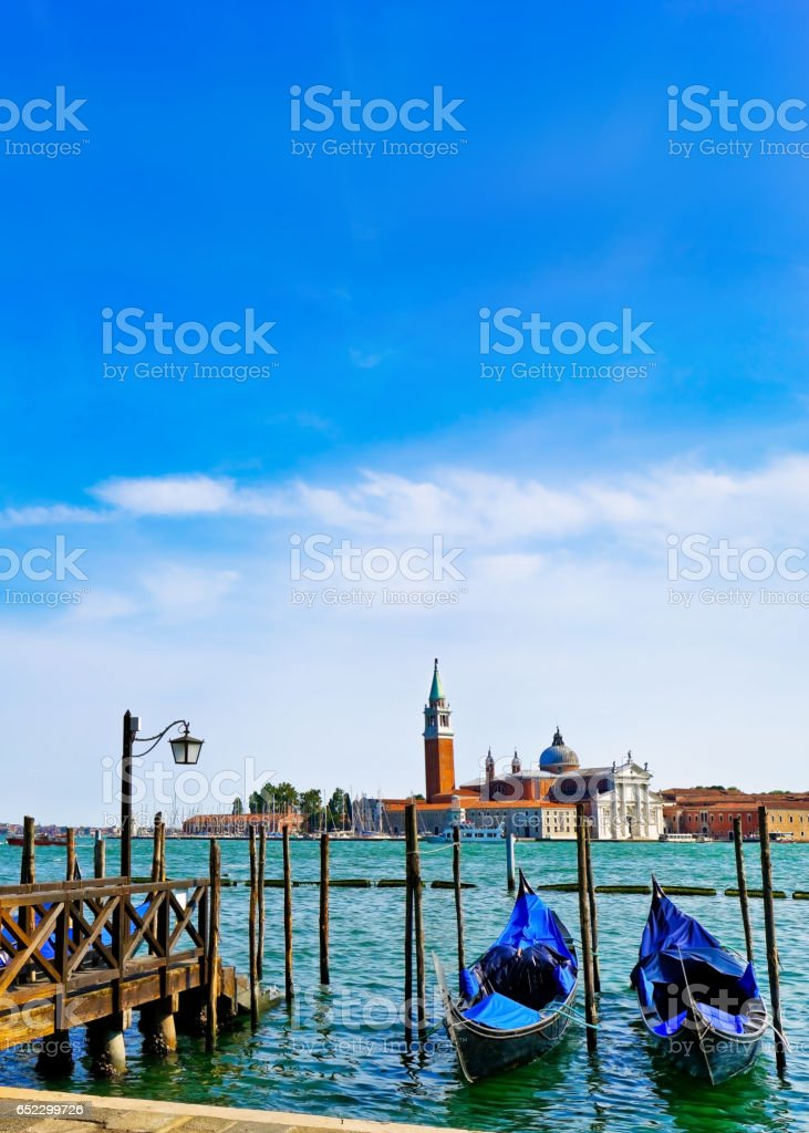 Gondolas moored on the canal in Venice stock photo
