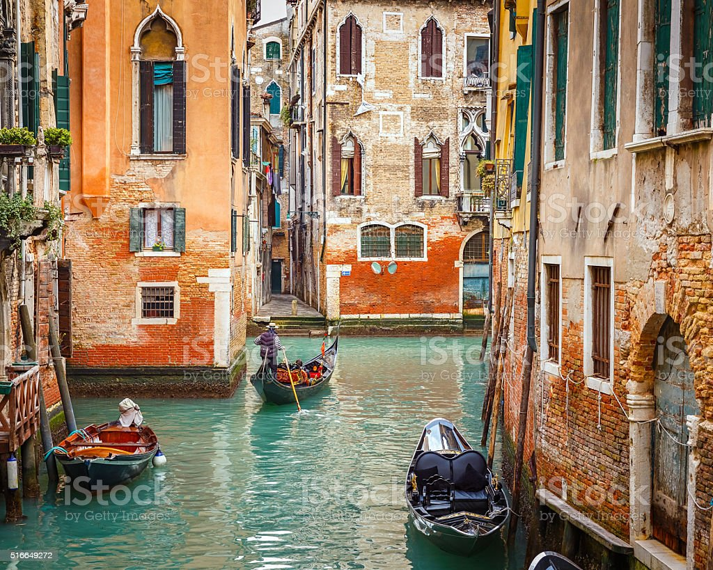 Gondolas on canal in Venice stock photo