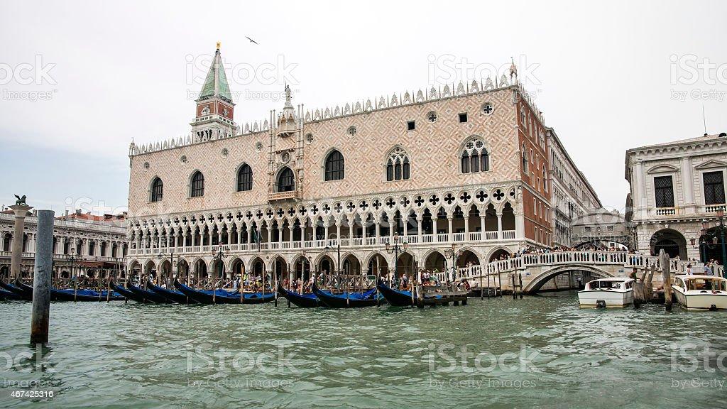 Gondolas parking near Doges palace in summer Venice stock photo