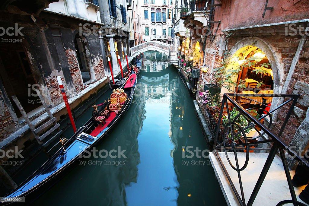 Gondolas & Restaurant at Dusk, Venice stock photo