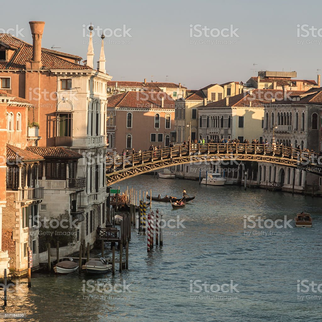 Gondolas under Ponte dell'Accademia in Venice stock photo