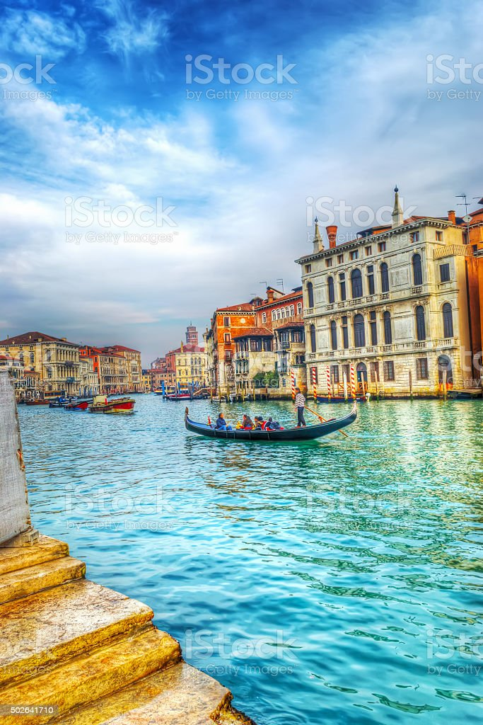 gondolier and tourists in Venice grand canal stock photo