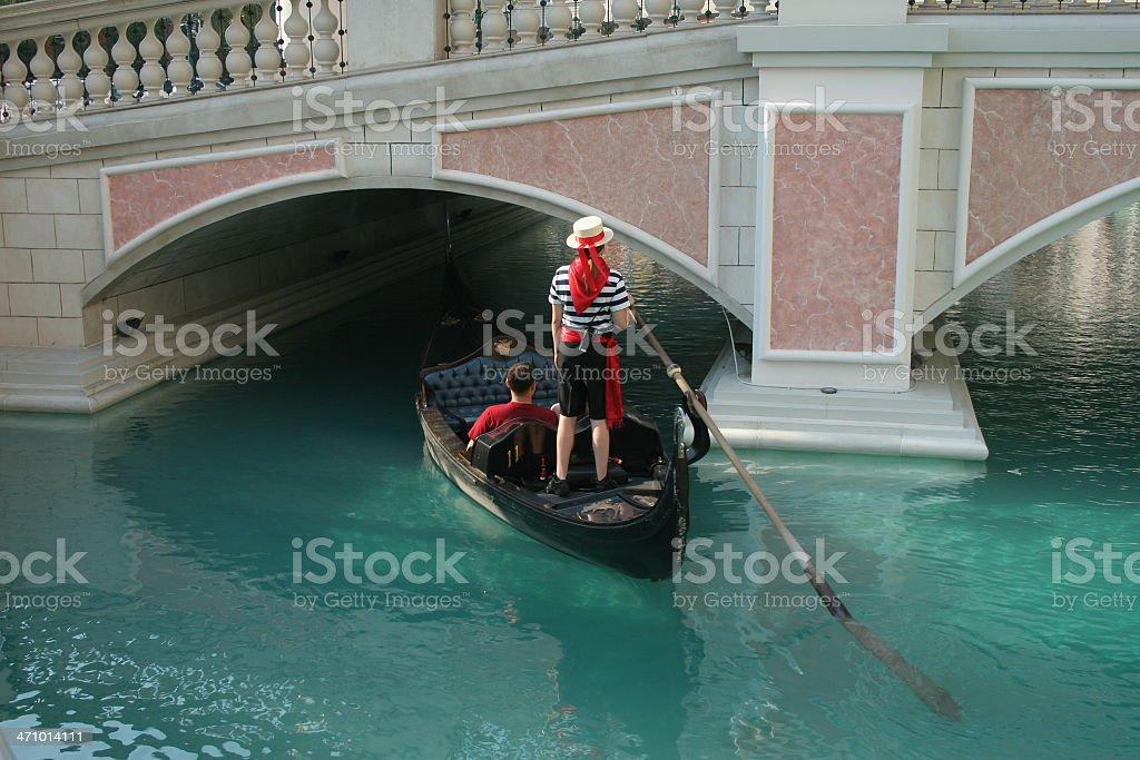Gondolier couple and gondola royalty-free stock photo