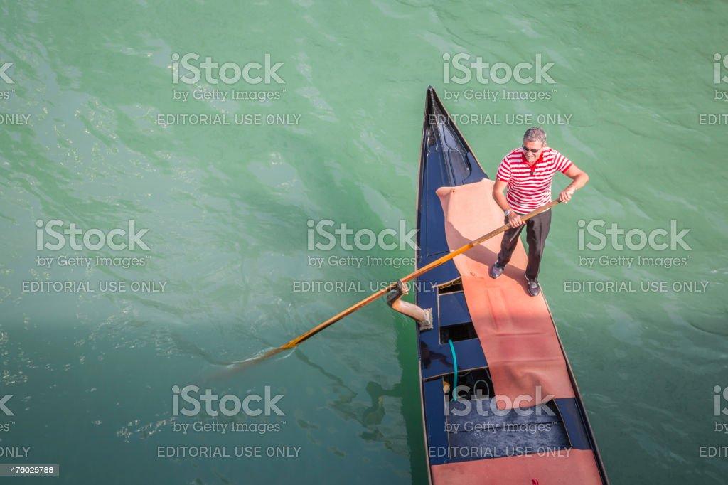 Gondolier in Venice, Italy stock photo
