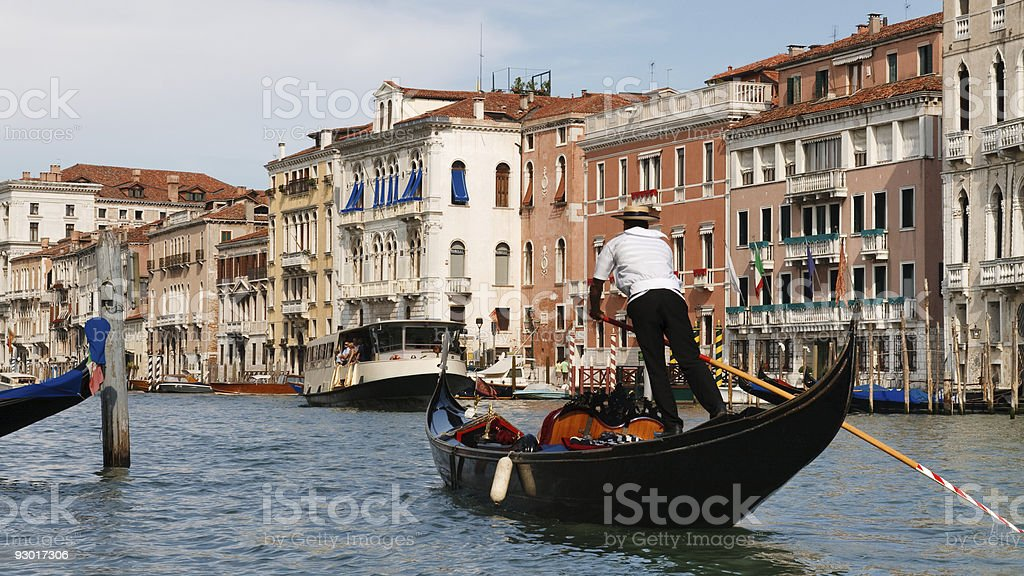 Gondolier on the Grand Canal in Venice, Italy stock photo