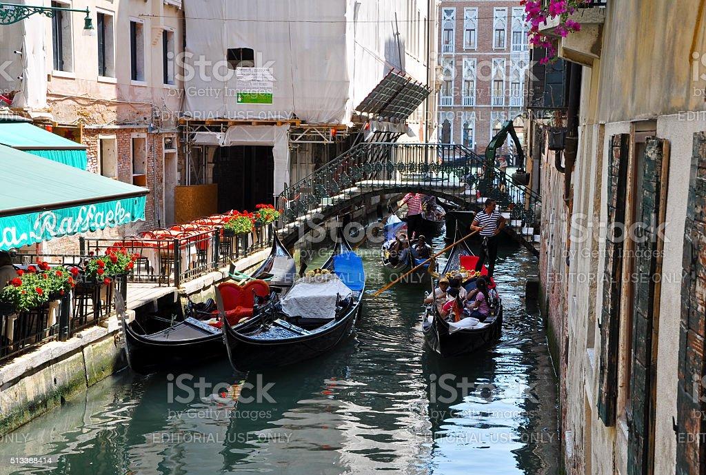 Gondolier runs the gondola in Venice, Italy. stock photo