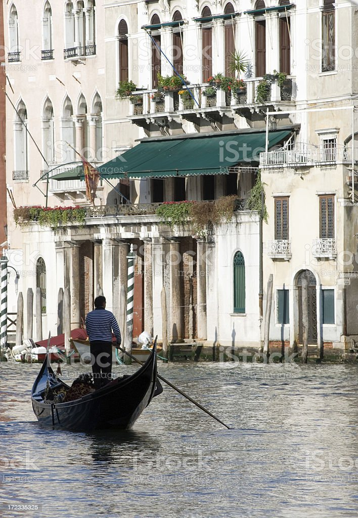 Gondolier silhouetted in Venice. royalty-free stock photo