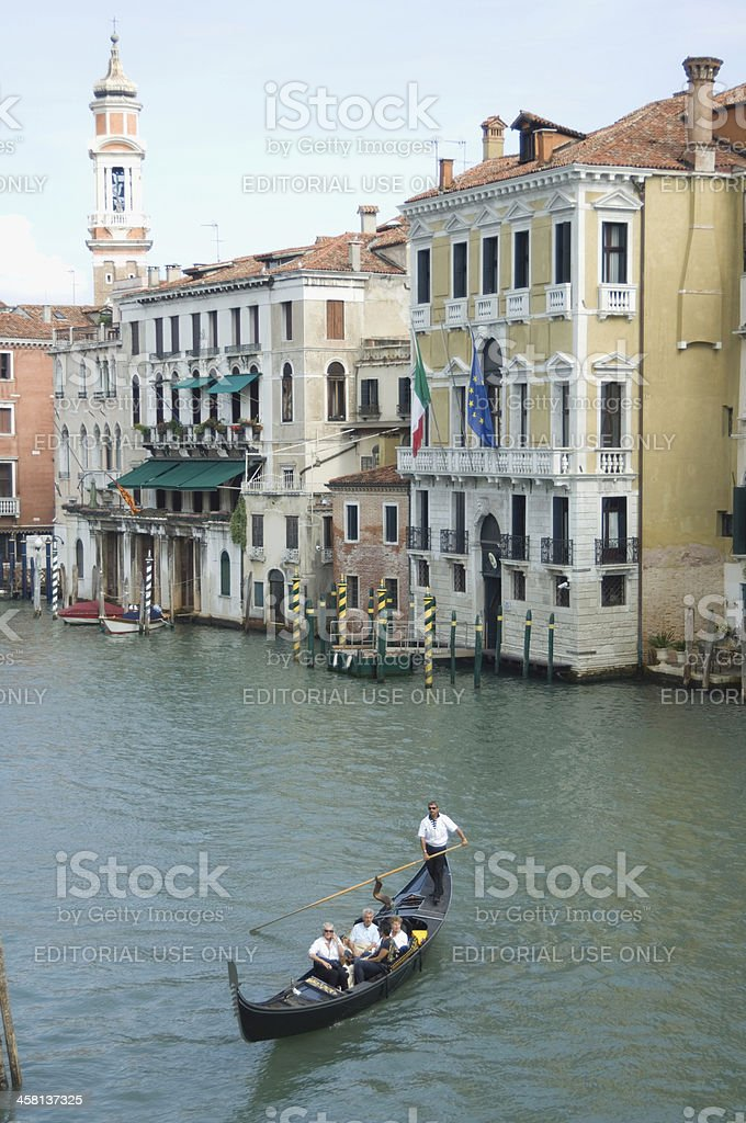 Gondolier with tourist passengers on Grand canal Venice royalty-free stock photo