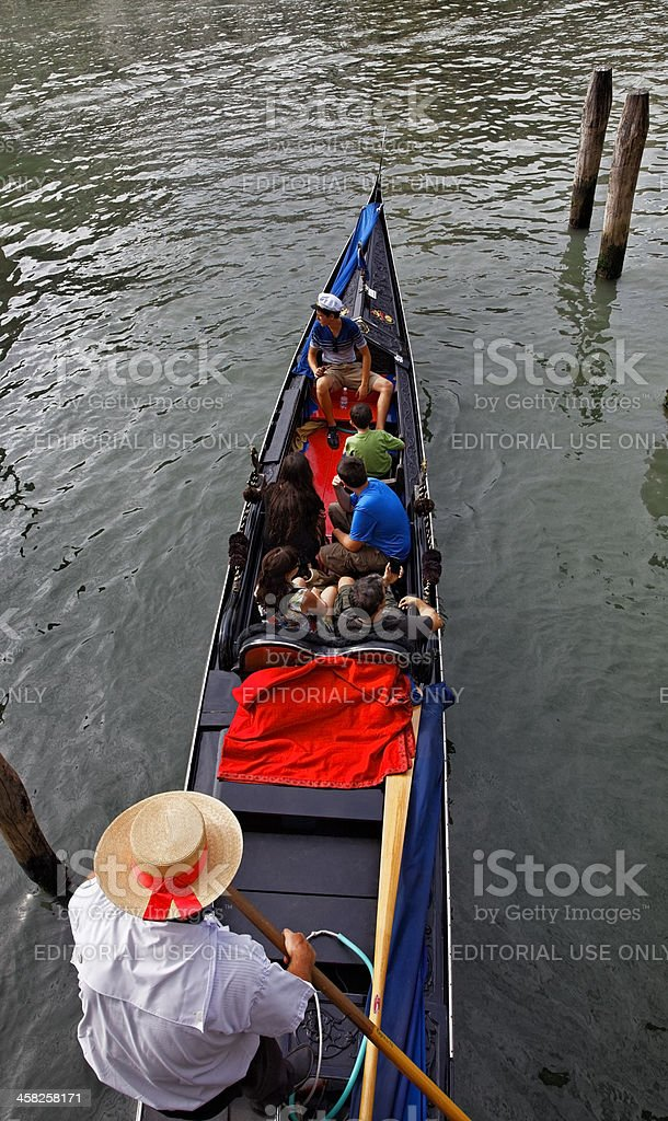 Gondolier with Tourists royalty-free stock photo