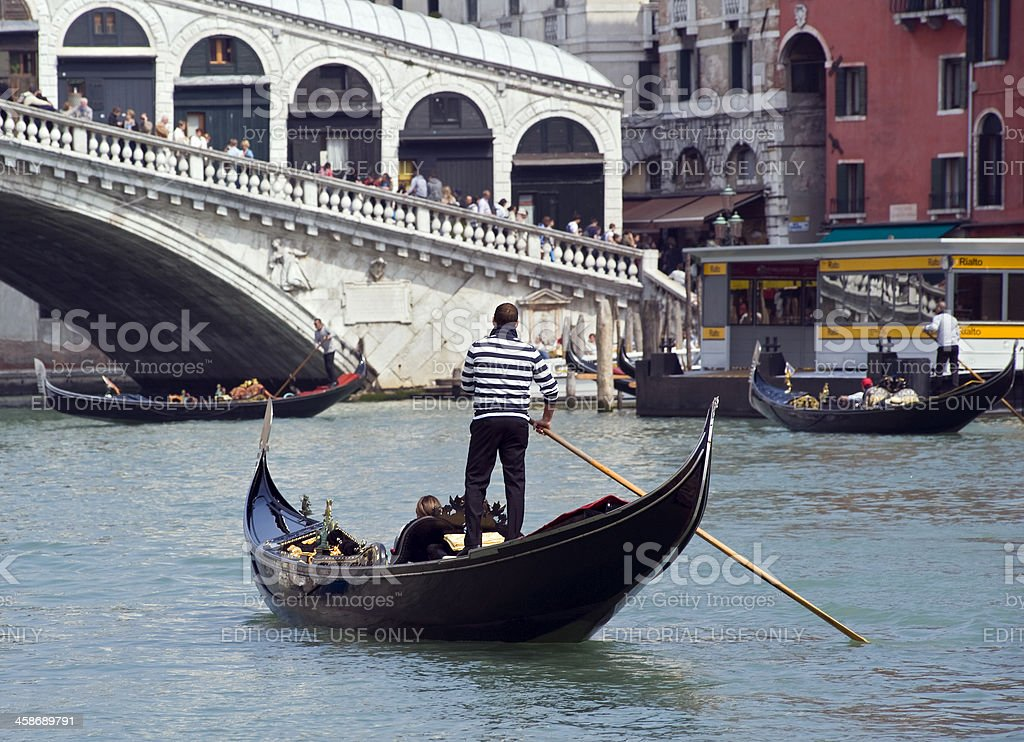 Gondoliere with tourists in the Canale Grande, Venice, Italy royalty-free stock photo