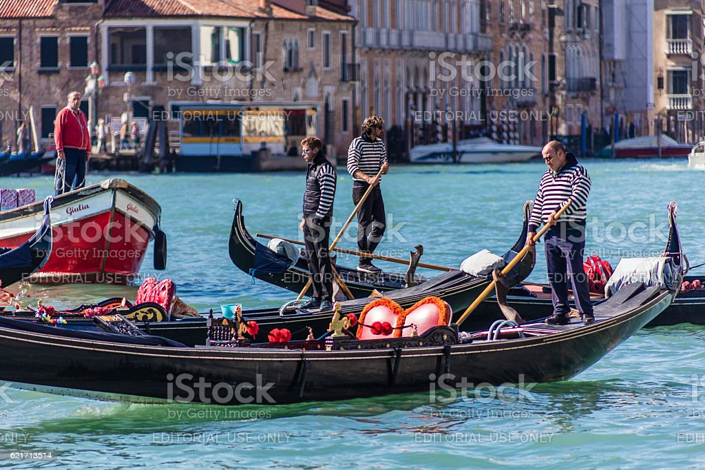 Gondolieries on Canale Grande in Venice, Italy stock photo