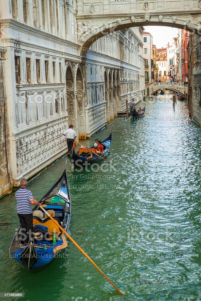 Gondoliers floating on a Grand Canal in Venice royalty-free stock photo