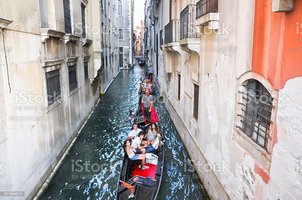 Gondoliers run the gondolas in Venice, Italy. stock photo