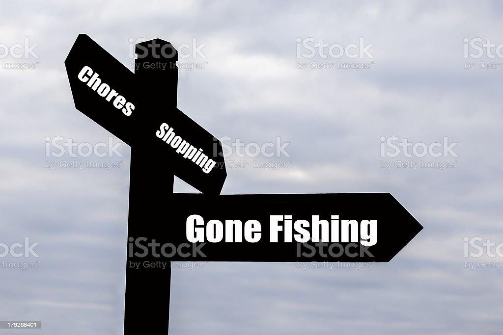 Gone Fishing Signpost. royalty-free stock photo
