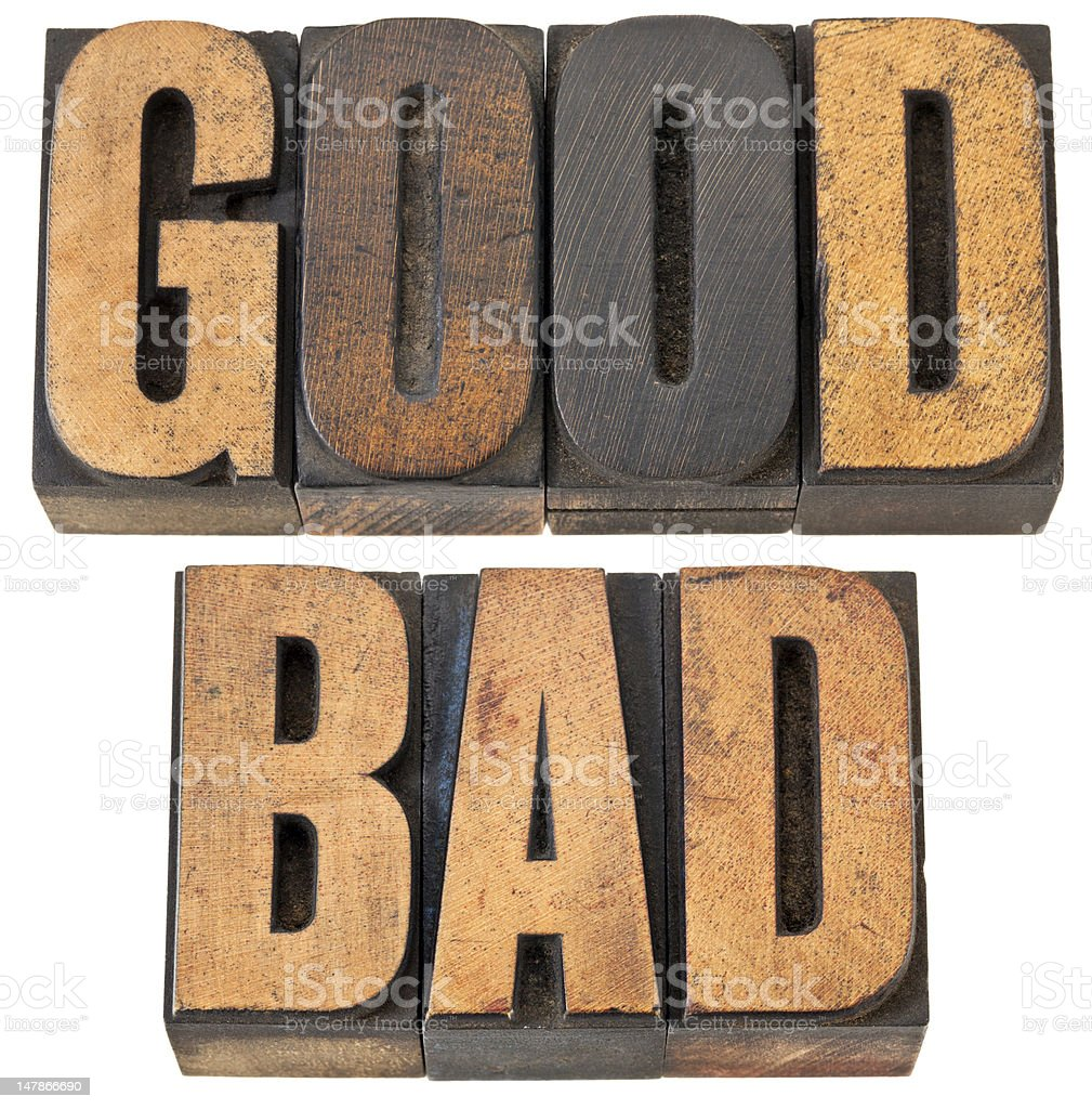 good and bad word in wood type stock photo