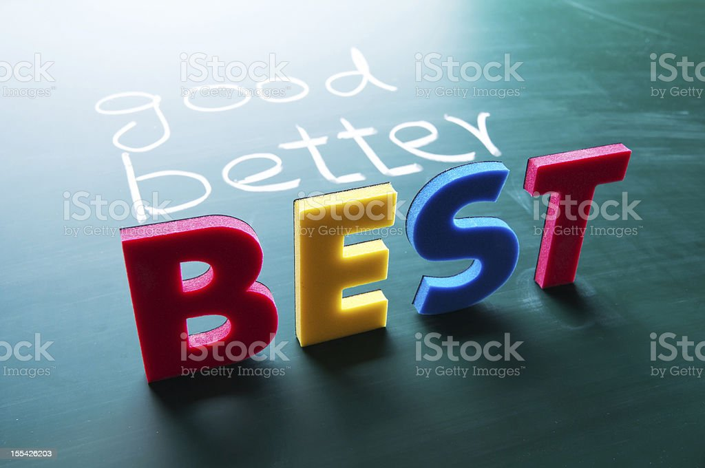 Good and better in chalk and best in colorful plastic letter royalty-free stock photo