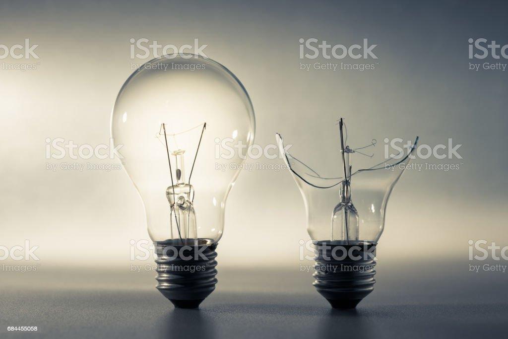 Good and Broken Light Bulb stock photo