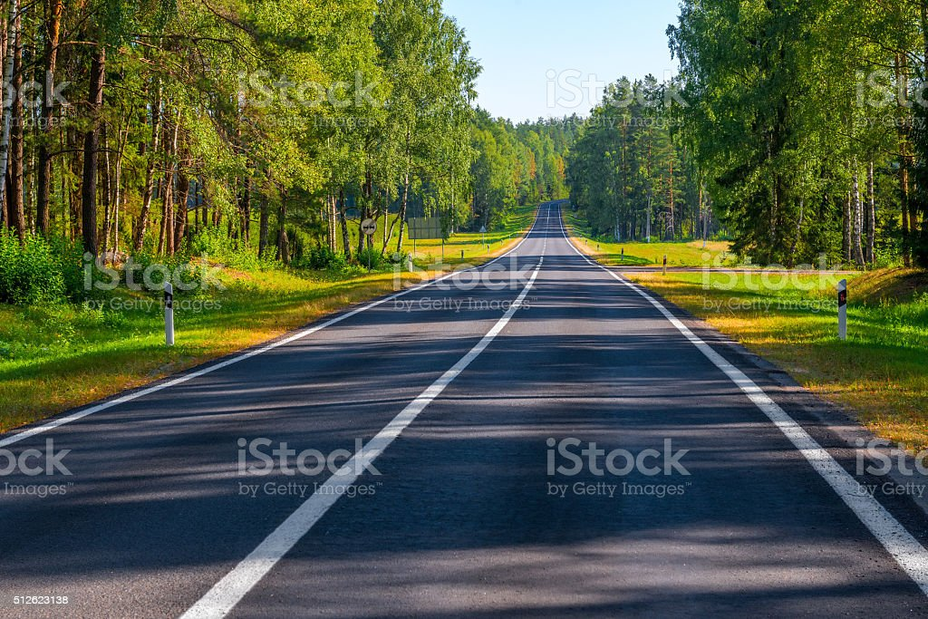 good asphalt road in the countryside in the early morning stock photo