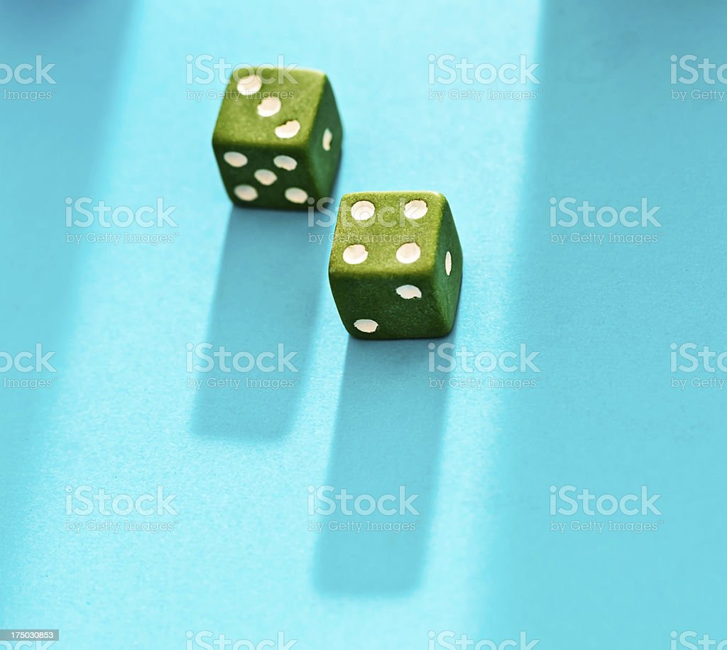 Good fortune or bad luck : green dice show 7 royalty-free stock photo