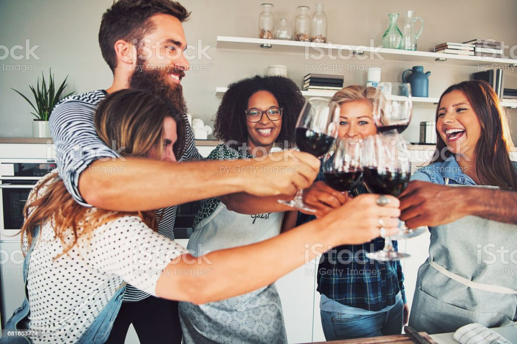 Good friends toasting with wine glasses stock photo