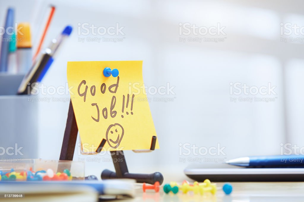Good job text on adhesive note stock photo