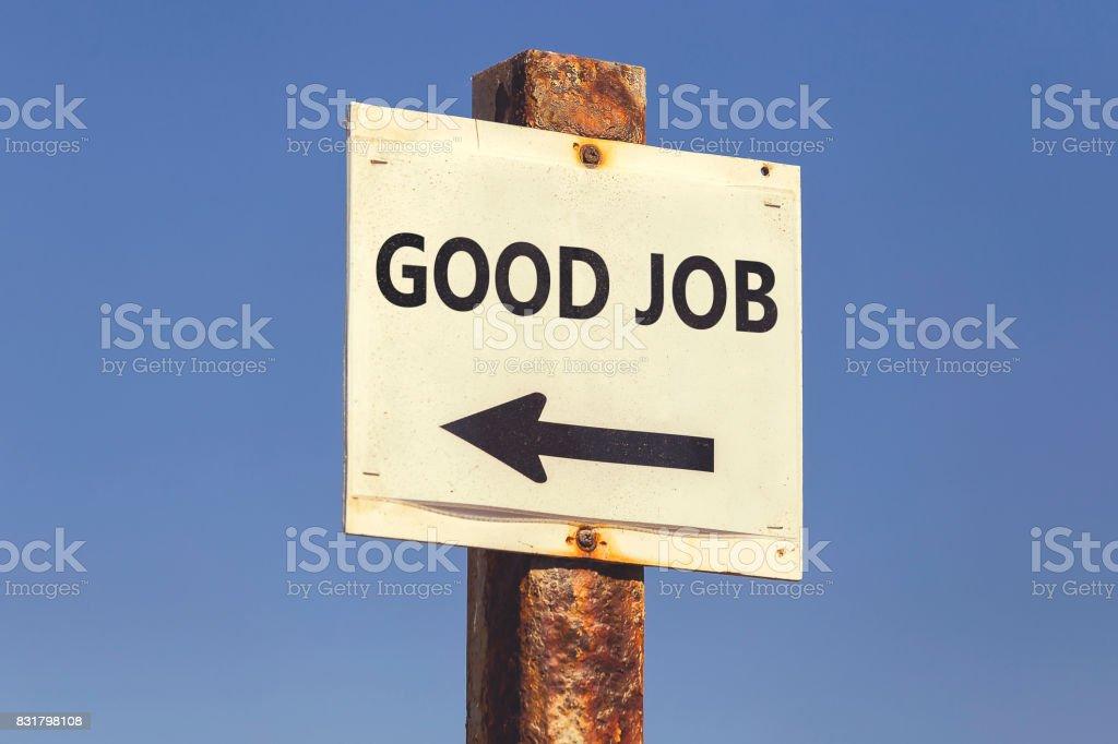 Good Job word and arrow signpost 2 stock photo