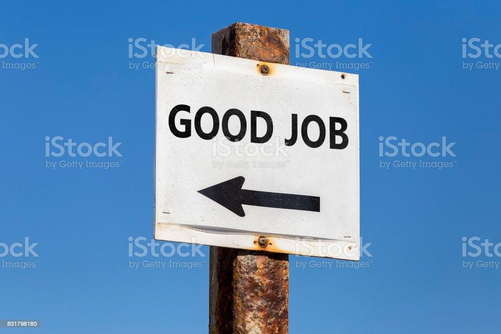 Good Job word and arrow signpost stock photo