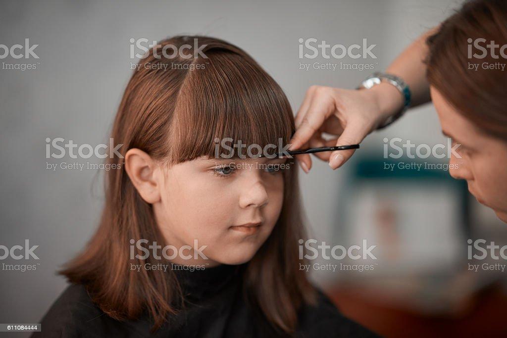 good little girl at hairdresser stock photo