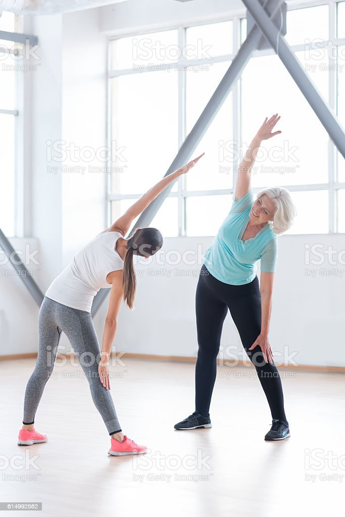 Good looking active women having a fitness class stock photo