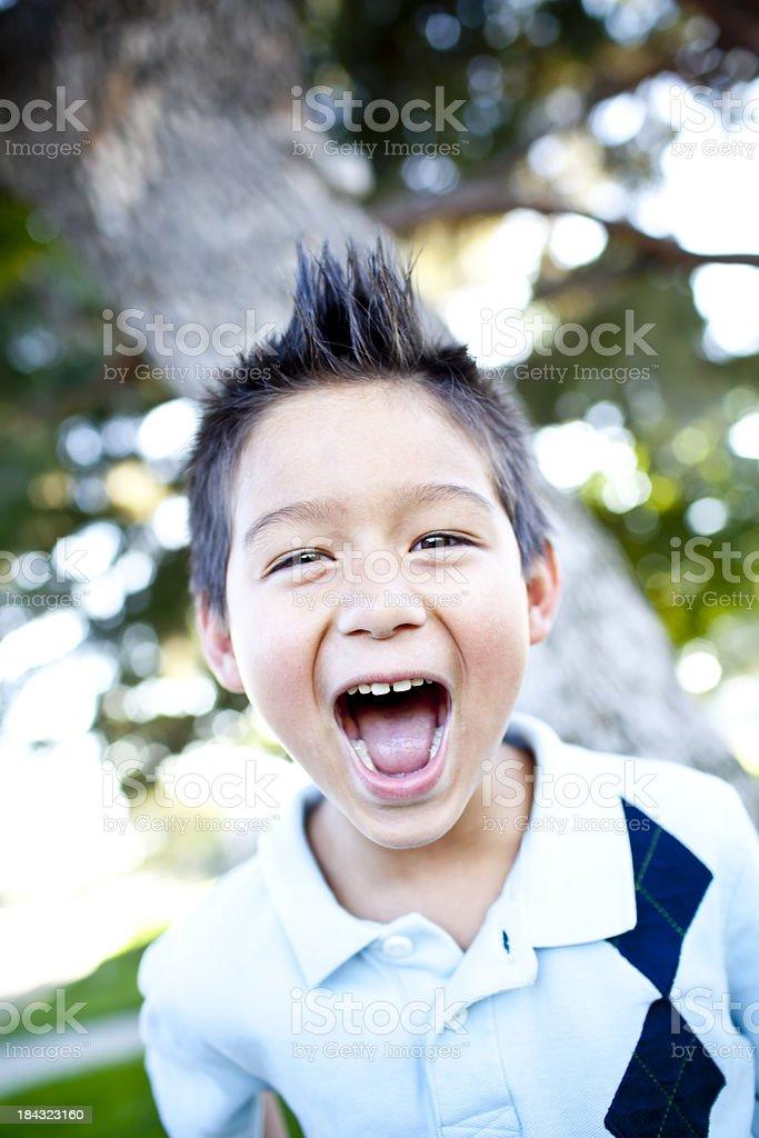 Good looking boy at the park having fun royalty-free stock photo